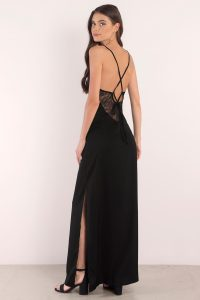Give me your love in the Channel Freedom Maxi Dress. A maxi dress with slit that features a deep v neck and crossing back straps. Turn heads with the open back lace up detail that's sure to wow at the gala, weddings, and during prom season.