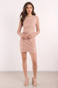 tobi.com Ready for romance in the My Lace Or Yours Bodycon Dress. With details so exquisite, you'll be falling for this lace bodycon dress featuring a lace overlay with a sheer back and long sleeves. For that extra fancy, style with platform heels and chandelier earrings - this party dress will have you feeling highly desirable.