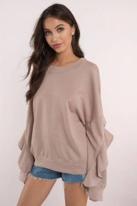 The perfect mix between comfy and chic, the Rachel Ruffled Sweatshirt is a must have. Featuring a crew neckline and ruffled sleeves. Pair this top with denim and booties.