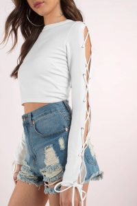 tobi.com - white long sleeve crew neck crop top with lace up sleeve detail