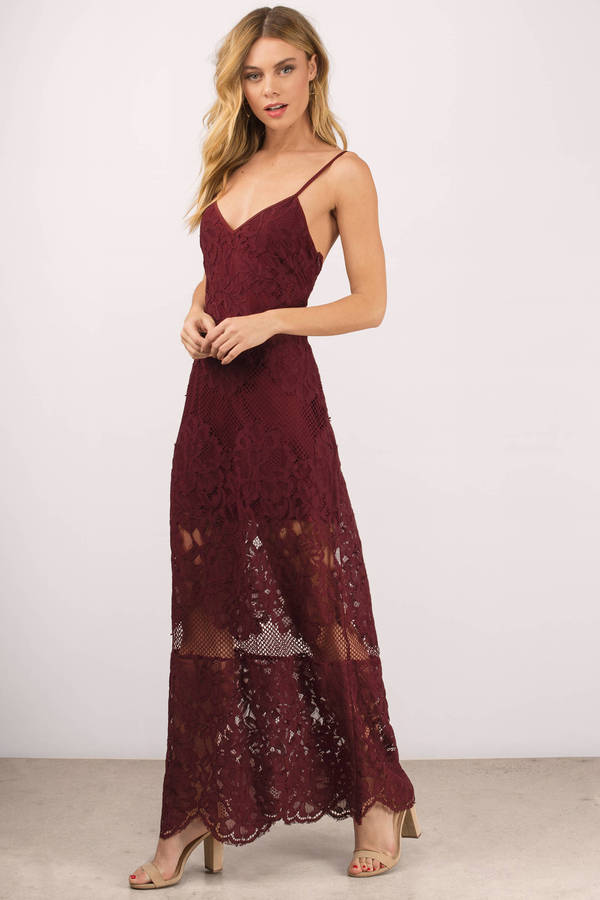 Tobi.com - She's foxy in the Wanderlust Lace Maxi Dress. Dressed to kill in this open back maxi dress featuring romantic lace overlay, adjustable thin straps and scalloped hem. On the edgy side of things, this open back maxi dress that would look great for special evenings and proms.