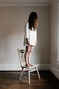 woman on chair by andrew neel on unsplash.com