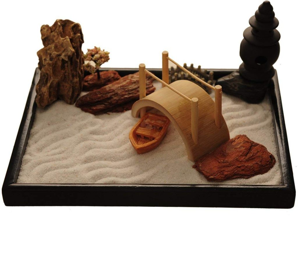 table top zen garden with bridges, rocks, and mini boat