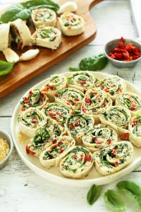 a plate of sun-dried tomato and basil pin wheels