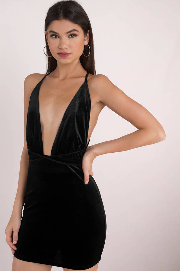 The Worth the Trouble Plunging Bodycon Dress featuring a plunging neckline and an open back detail.