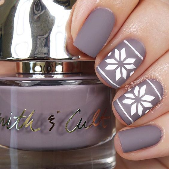 matte purple snowflake nails