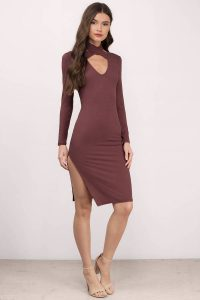 Make a statement in the Natalie Wine Red Cross Front Ribbed Midi Dress. Featuring a criss-cross front detail and side slits. Pair with ankles strap heels to complete the look.