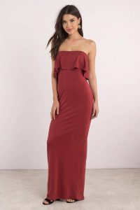 Stand out in the Milan Maxi Dress. Featuring strapless ruffle detail and back slit on a maxi dress. Pair with heels.