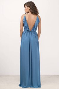 Hello, my love in the Zeze Plunging Maxi Dress. A sophisticated maxi dress with a plunging surplice neck and elegant ruffle trim detail along the back v scoop. Flows gracefully to your every step with a revealing side slit. Oh love, be ready for the double takes.