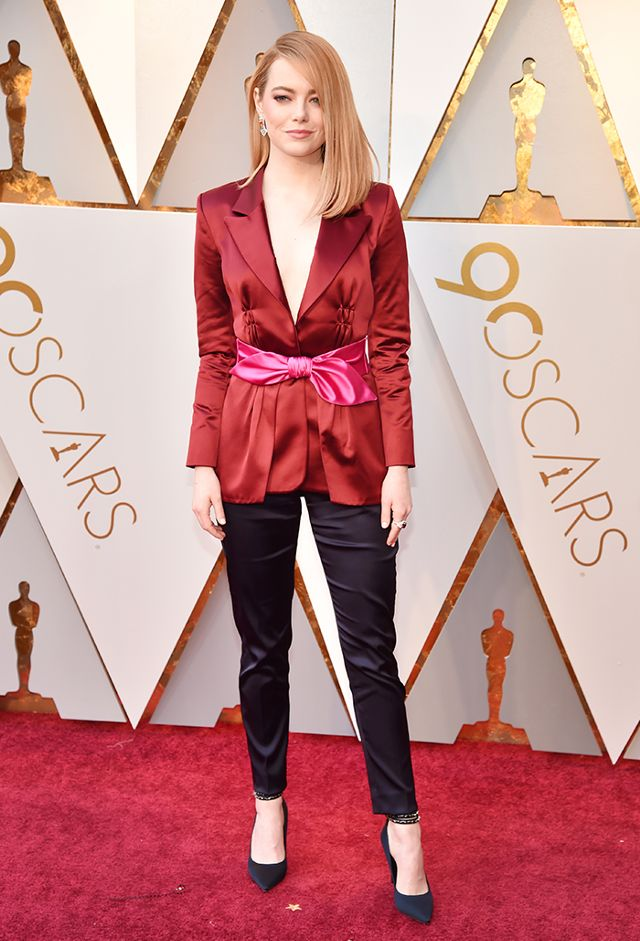 Emma Stone wearing a chic blazer and pants look at the Oscars.