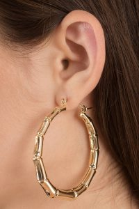Shop the INTO THE WILD GOLD BAMBOO HOOP EARRINGS at tobi.com!