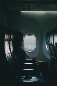budget travel destinations: woman in a plane