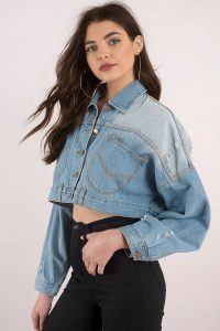Don't miss out on the Lana Cropped Denim Jacket. Featuring cropped fit and distressed details. Pair with a black dress and booties.