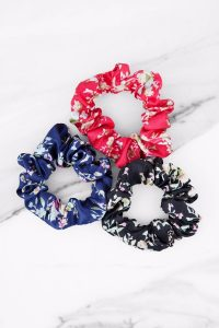 Shop the GROUP PROJECT MULTI FLORAL HAIR TIE SET at tobi.com!