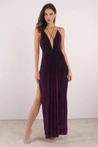 Turn heads in the Maxine Velvet Maxi Dress. Featuring a velvet material, criss cross straps and a panty under-layer with a thigh high slit. Pair with ankle strapped heels.