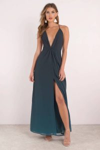 Get your hands on the Ariel Ombre Maxi Dress. Featuring a knotted front, open center slit, and ombre fabrication- this dress will surely be a hit. Pair with simple heels.