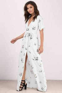 You'll fall in love with the Emma Floral Maxi Dress. Featuring a front wrap maxi dress. Pair with heels and casual jewelry.