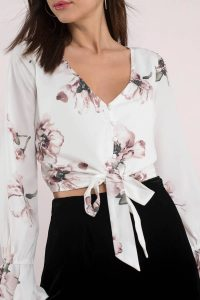 Shop the QUINN WHITE FRONT BUTTON TOP at tobi.com!