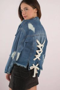 I'M YOURS MEDIUM WASH LACE UP DISTRESSED DENIM JACKET at tobi.com!