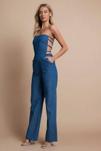 Shop the LOVE IS NOT OVER MEDIUM WASH CHAMBRAY JUMPSUIT at tobi.com!