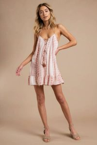STILL HERE RUST LACE UP SWING DRESS at tobi.com!