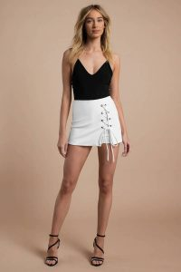 REBECKA WHITE LACE UP MINI SKORT at tobi.com!