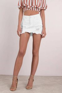ELSA WHITE DISTRESSED DENIM SKIRT at tobi.com!
