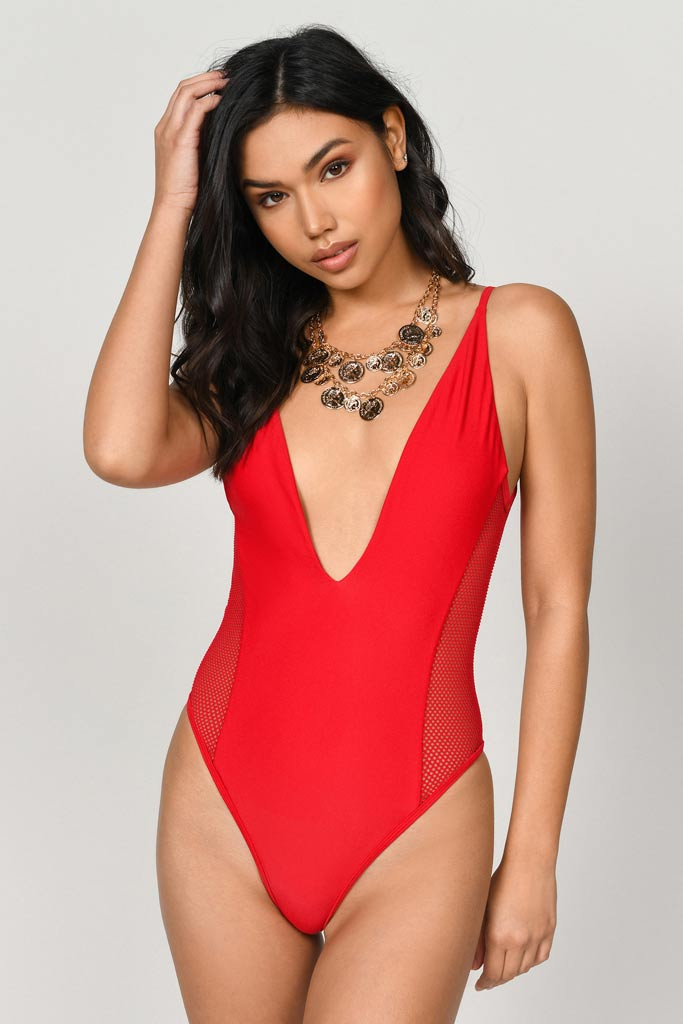 A red one piece swimsuit with a racerback cut